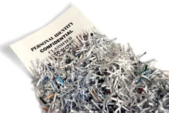 Image of a confidential document halfway shredded