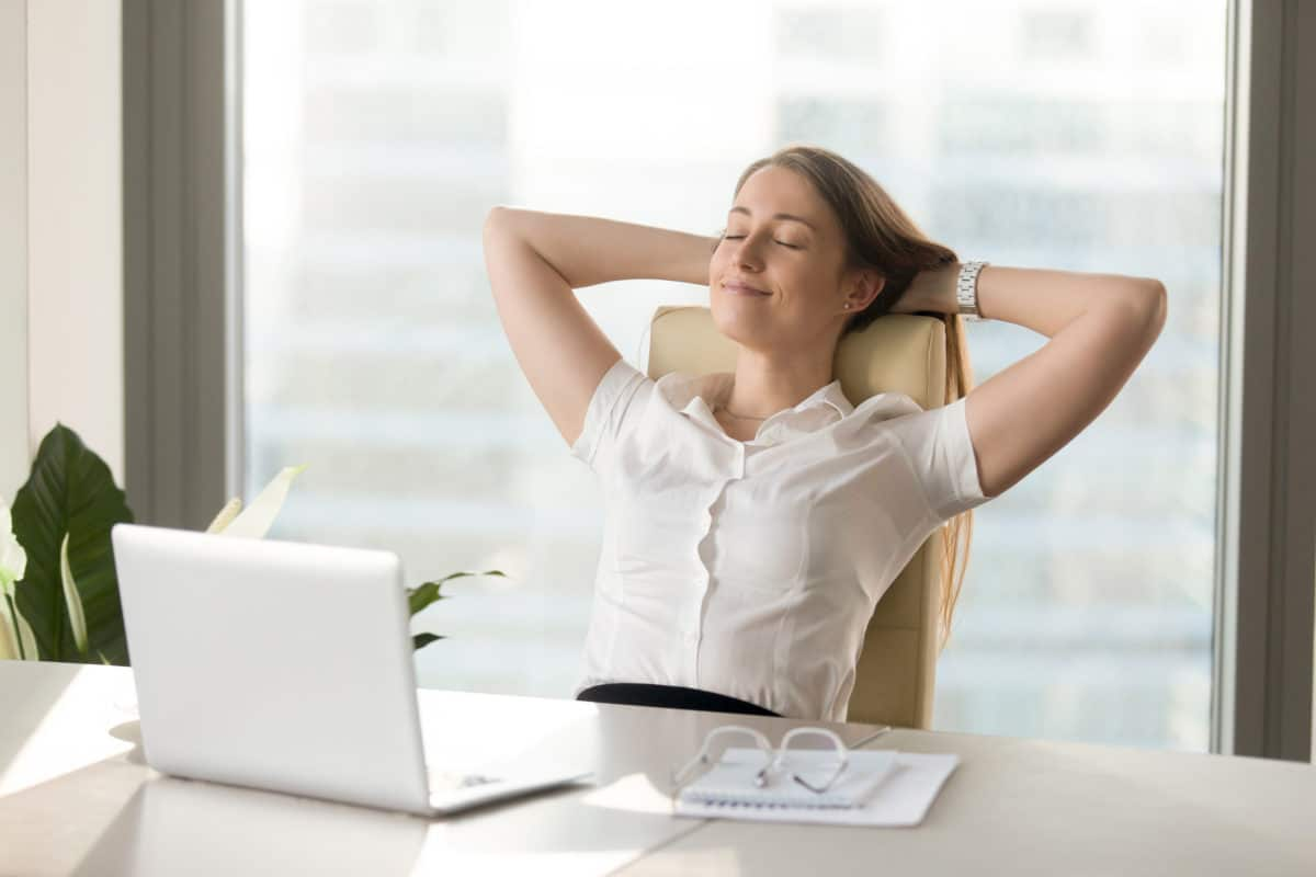 woman relaxing at desk