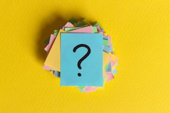 colorful question marks written reminders tickets. ask or business concept.